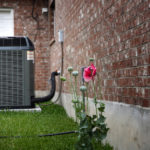 Outdoor AC unit during Spring