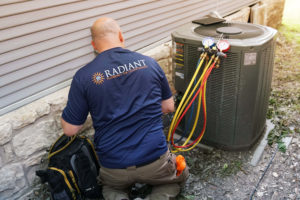 HVAC contractor working on repairs.