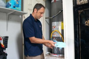 worker repairs furnace in Austin, TX home