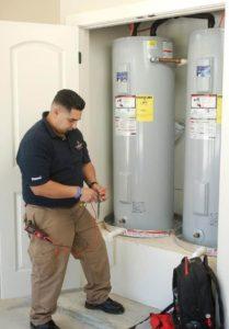 worker installing hot water heater in Austin, TX