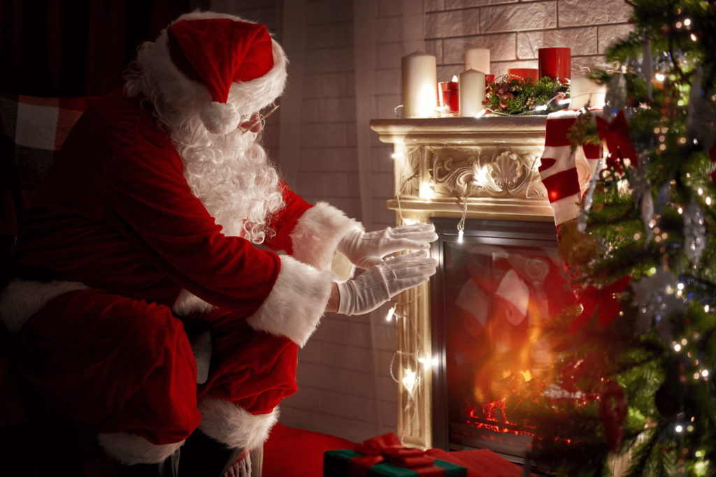 Radiant - Santa Claus Warming Up by the Fire