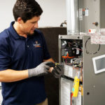 Radiant specialist performing furnace repairs